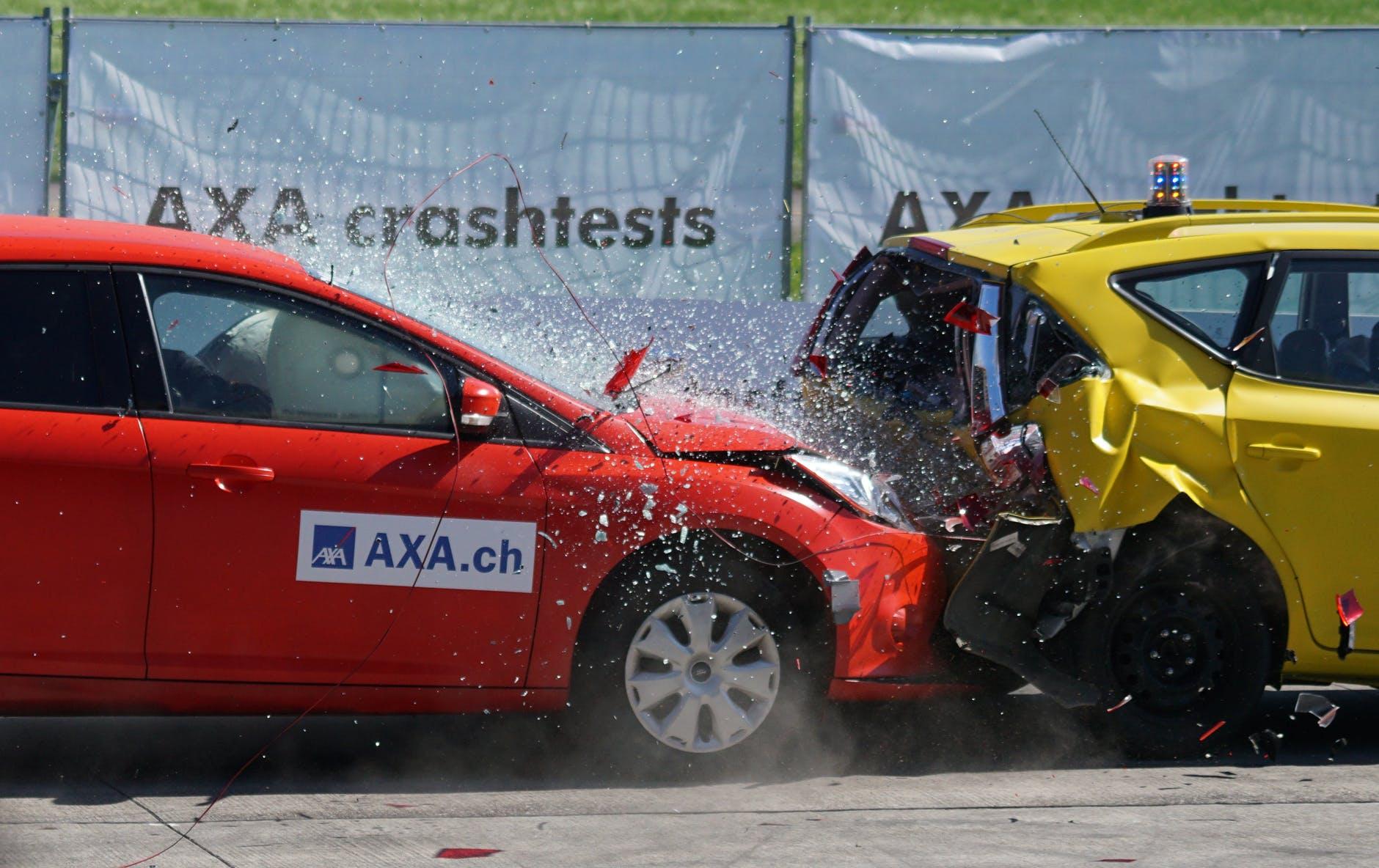 red and yellow hatchback axa crash tests