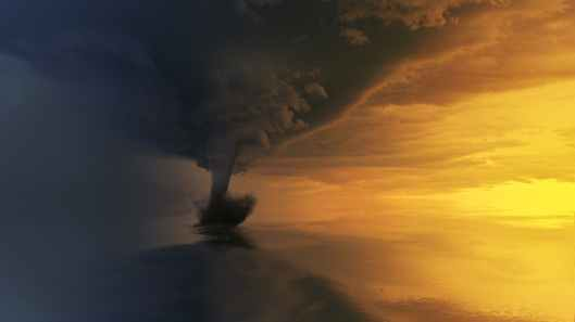 tornado on body of water during golden hour