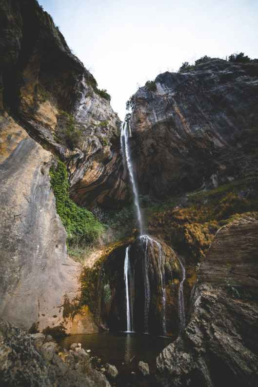 photography of flowing plunge waterfall