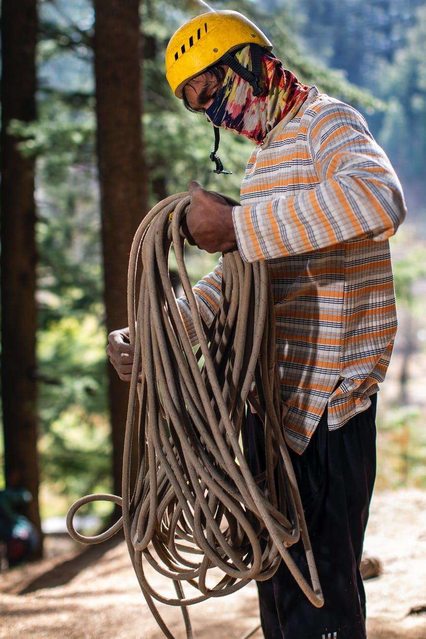 photo of man holding rope