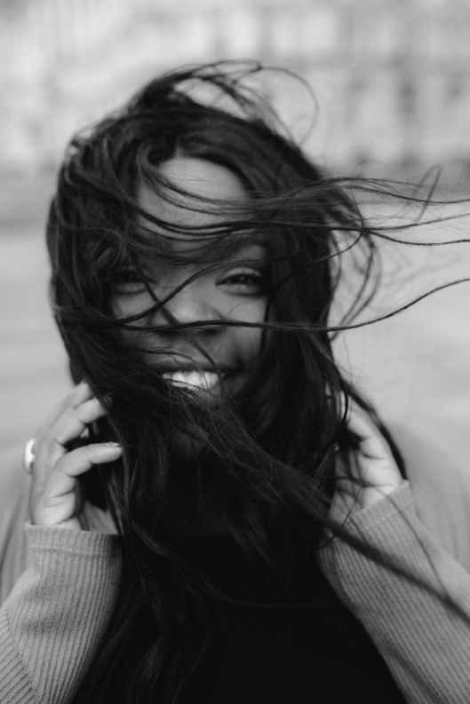 monochrome photo of woman smiling