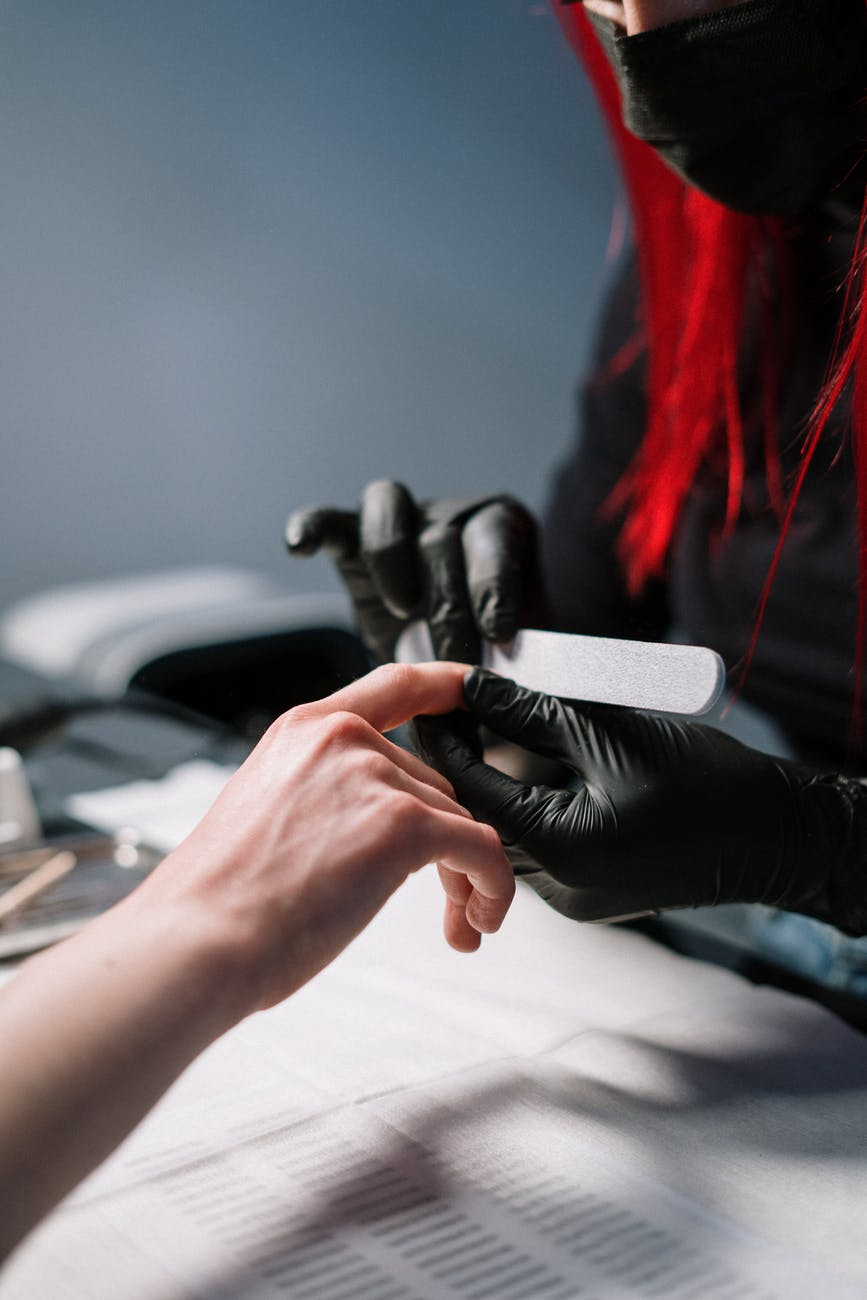 person holding black and red hair brush